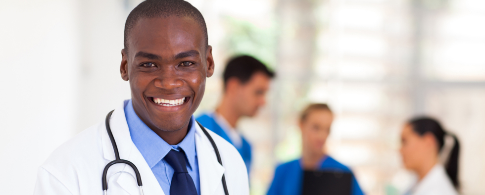 male black american doctor with nurse in the background