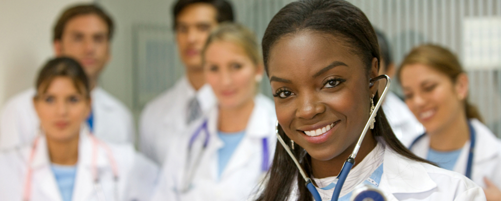 female black american doctor with other doctors in the background